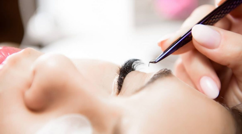 beautiful-young-woman-during-eyelash-extension-close-up